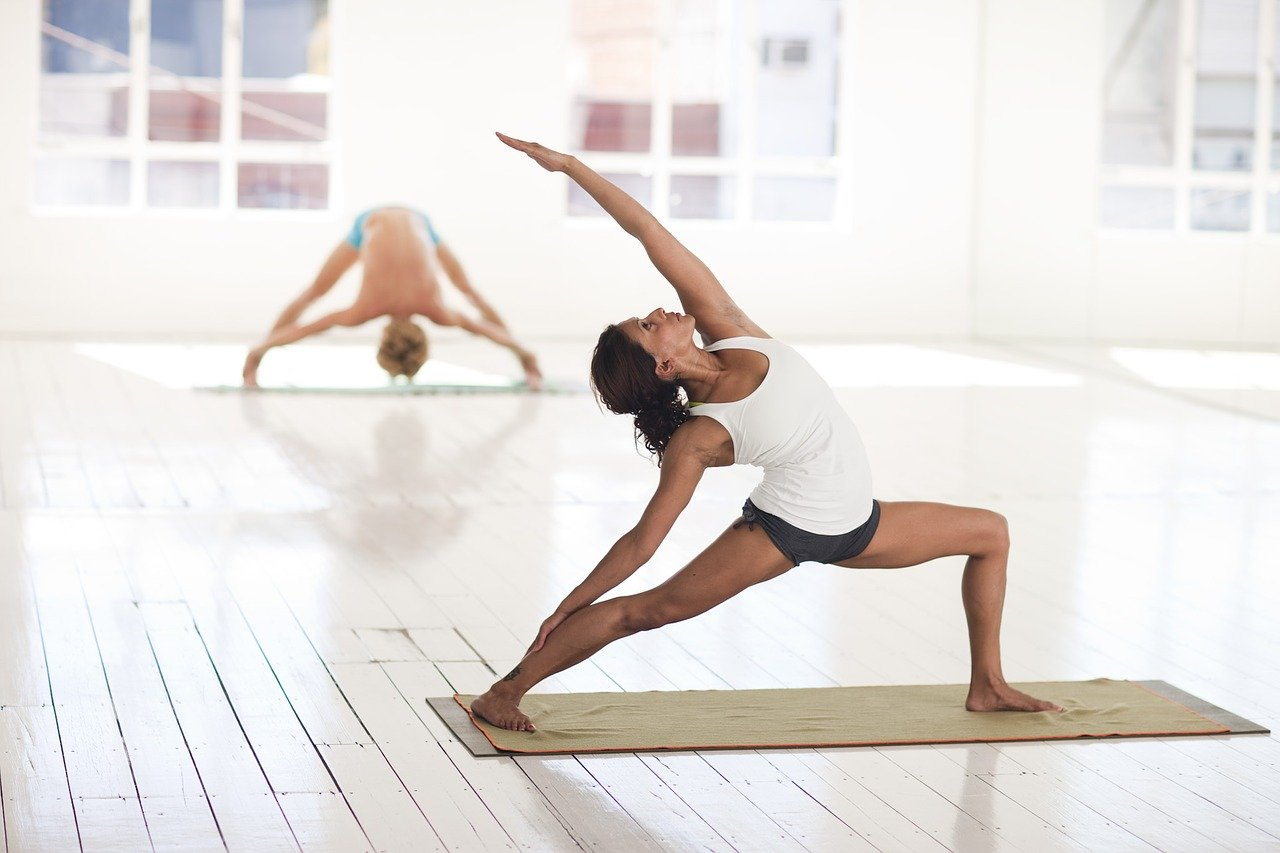 Yoga ist eine Trendsportart bei Firmenfitness